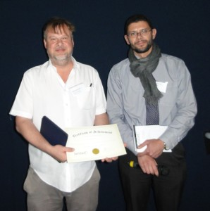 Dr Nigel Temperton (Universities of Greenwich and Kent at Medway,UK) accepting the poster prize on behalf of Keith Grehan with poster judge, Dr Romain Paillot (Animal Health Trust, UK)