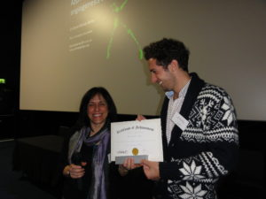 Professor Patrizia Ferretti (UCL Institute of Child Health, London, UK) and Gaston Primo accepting poster prize award on behalf of Karla Inostrozo Brito