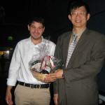 Mr Emre Fertan (Dalhousie University ,Canada) receiving his feedback prize from Dr Chuang-Kuo Wu (Director, Alzheimer's Disease Program, Texas Tech University Health Sciences Centre, School of Medicine, Texas, USA)